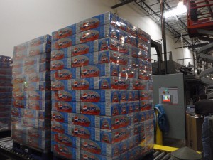Finished product is palletized and shrink wrapped for stocking in warehouse