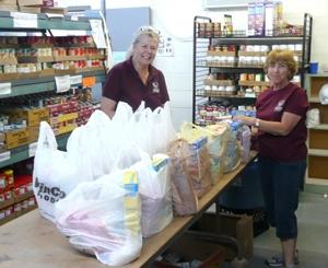Volunteers fill food bags at the Meridian Food Bank.