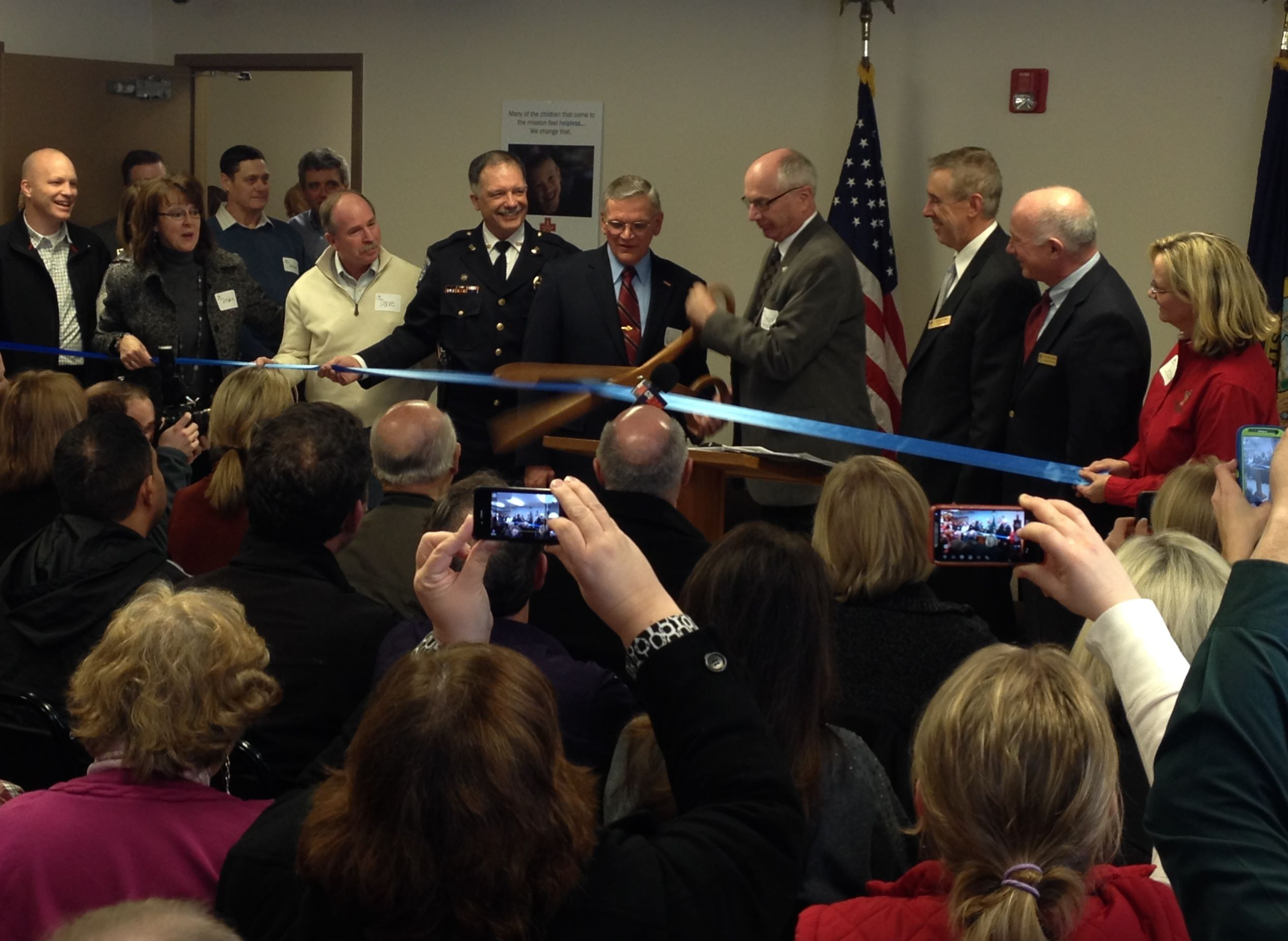 Mayor Bob Henry cuts the ribbon to open the Nampa shelter for women and children, operated by the Boise Rescue Mission.